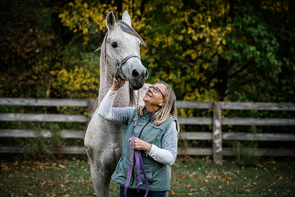 A woman with her Arabian Horse in the paddock in Markdale. Owen Sound Equine photographer horse photographer equine photography